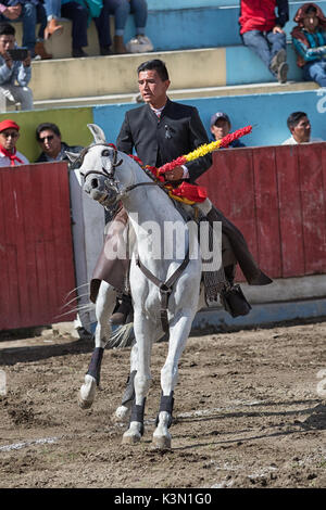 June 18, 2017, Pujili, Ecuador: bullfighter in the arena bringds his horse to a quick stop - Stock Photo