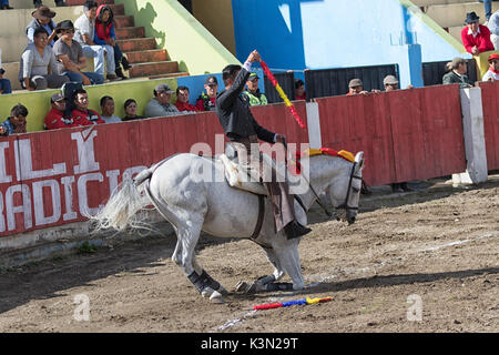 June 18, 2017, Pujili, Ecuador: bullfighter in the arena brings is horse to its knees as a salute to the spectators - Stock Photo