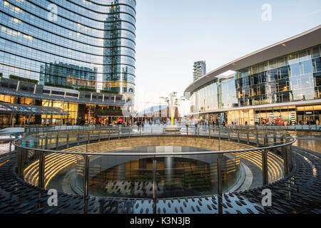 Milan, Lombardy, Italy. Gae Aulenti square in the Porta Nuova business district. - Stock Photo