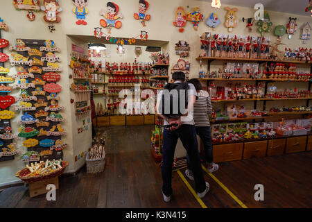 Tourists at souvenir shop in Rome, Italy - Stock Photo