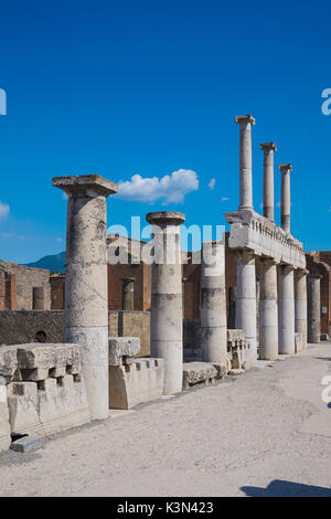Remains of colonnade at the Roman ruins of Pompeii, Italy - Stock Photo