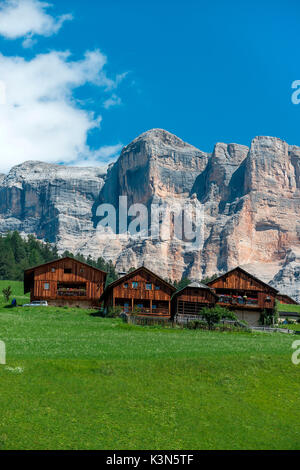 Alta Badia, Dolomites, South Tyrol, Italy. Les Viles are typical Ladin houses. In the background the Sass de la - Stock Photo