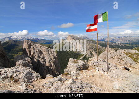 Dolomites, Veneto, Italy. Sign of peace on Sasso di Stria. In the background the Marmolada - Stock Photo