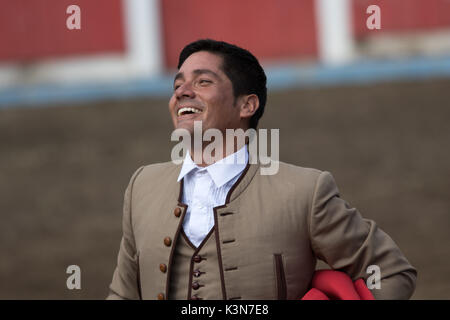 June 18, 2017 Pujili, Ecuador: bullfighter with a happy smile moments after the sacrifice of the bull - Stock Photo