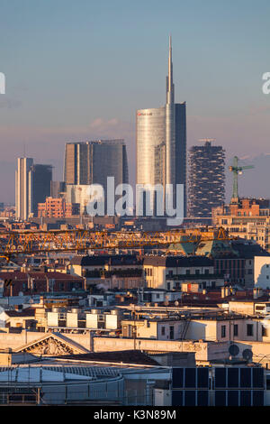 Milan, Lombardy, Italy. A view of city from the top of Cathedral at sunset. - Stock Photo