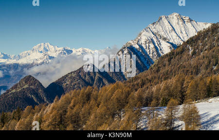 Different ridges in front of me: first, the hardest east ridge of Zerbion, and over the clouds, in the background, - Stock Photo