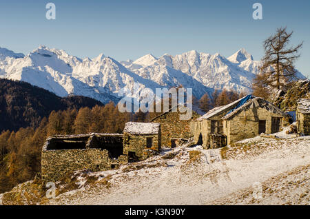 An abandoned little village, with the ridges of central valley of Vallée d'Aoste. (Val d'Ayas, Vallée d'Aoste, Italy) - Stock Photo