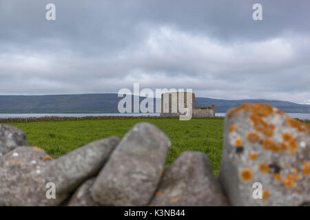 Ruins of Martello tower and barracks at Finavarra Point, Co.Clare, Ireland, Europe. - Stock Photo
