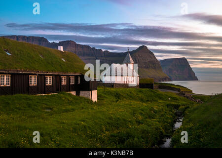 Vidareidi village, Vidoy island, Faroe Islands, Denmark. Village's church at sunset. - Stock Photo