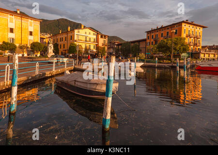 Iseo, Lake Iseo, Lombardy, Italy. The port and the Iseo lake at sunset - Stock Photo