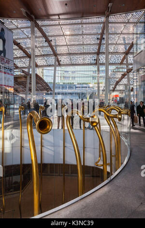 Milan, Lombardy, Italy. Near Gae Aulenti square you can find these trumpets that allow two people to speak on different - Stock Photo