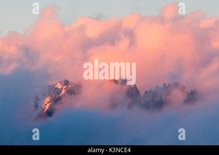 Europe, France, Pointes d'Orient. Amazing sunset with red clouds over mountains of France Alps - Stock Photo