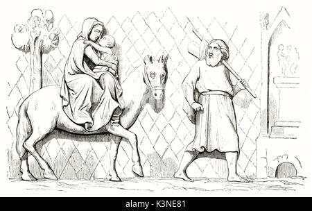 Woman on a horse with her baby behind a man leading on foot. Old reproduction of a bass relief in Notre-Dame de - Stock Photo