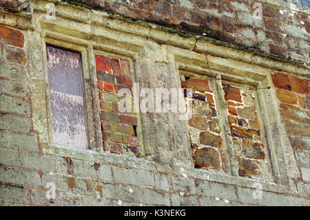 16th century manor houses windows and stonework window tax period property blocked out bricked up widows wolverton - Stock Photo