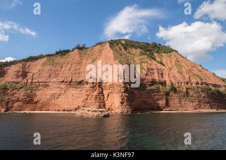 High Peak rises above a triassic rock stack near Ladram Bay, Sidmouth, Devon. - Stock Photo