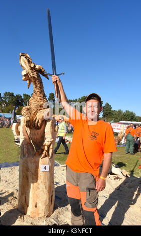 Raimondas Ubdravis & his winning entry at the Scottish Chainsaw Carving competition, held on Saturday 2nd September - Stock Photo