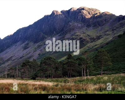 The top of Haystacks lit by the late evening sun, Buttermere Valley, Cumbria, United Kingdom - Stock Photo