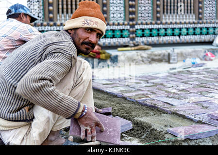 Leh, India - August 21, 2015: View of an unidentified man working in Leh main street. Leh was the capital of the - Stock Photo