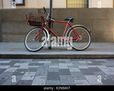 A red vintage bicycle  with a basket - Stock Photo