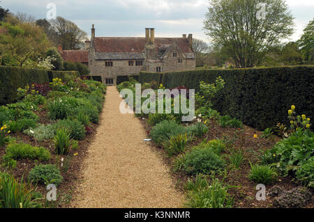Mottistone Manor House on the Isle of Wight showing the formal gardens an stone steps with walls and symmetrical - Stock Photo