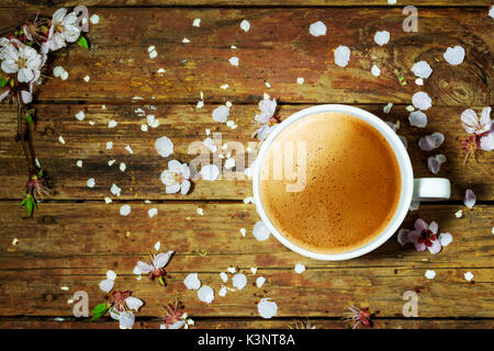 Sping background with flowers and cup of cofee - Stock Photo