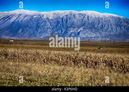 Galicica / Mali i Thatë mountain range between Albania and Macedonia covered with snow - Stock Photo