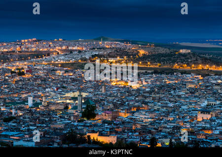 Fes, Morocco, Africa. Panoramic view of the medina in the blue hour. - Stock Photo