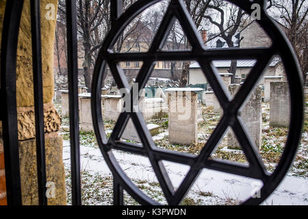 Krakow, Poland, North East Europe. Star of David symbol on the fence of the old Jewish cemetery. - Stock Photo