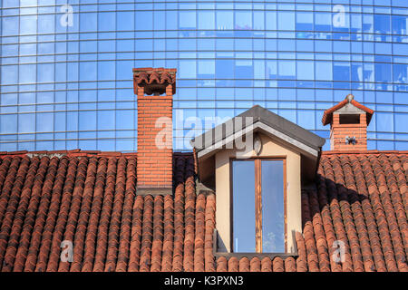 The contrast between old typical houses and new modern buildings and skyscrapers Milan Lombardy Italy Europe - Stock Photo