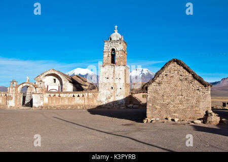 The church of Sajama and volcano Parinacota and Pomerape (Les Nevados de Payachatas). The Sajama Pueblo, in the - Stock Photo