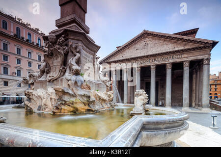View of old Pantheon a circular building with a portico of granite Corinthian columns and its fountains Rome Lazio - Stock Photo