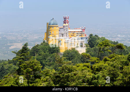 The colorful and decorated castle Palácio da Pena on top of hill São Pedro de Penaferrim Sintra Lisbon district - Stock Photo