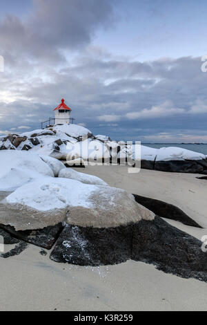 The blue arctic dusk on the lighthouse surrounded by snow and icy sand Eggum Vestvagoy Island Lofoten Islands Norway - Stock Photo