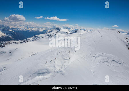 Aerial view of Forni Glacier and alpine skiers on Mount Cevedale Valtellina Lombardy Italy Europe - Stock Photo
