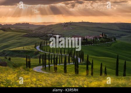 Europe, Italy, Baccoleno farmhouse at sunset, Crete Senesi, province of Siena. - Stock Photo