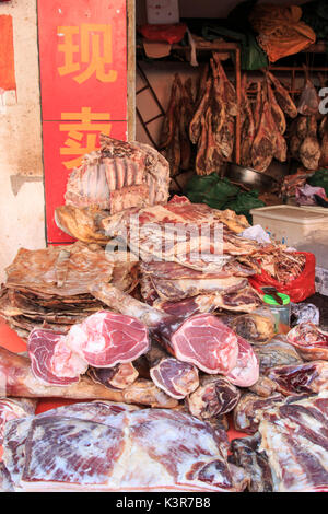 Meat for sale in a traditional market of Kunming in China - Stock Photo