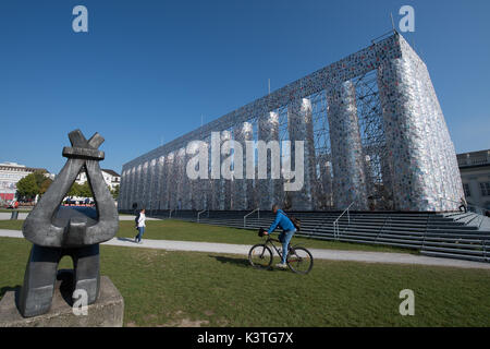 Forbidden books wrapped in plastic hang on the finalized documenta artwork 'The Parthenon of Books' in Kassel, Germany, - Stock Photo