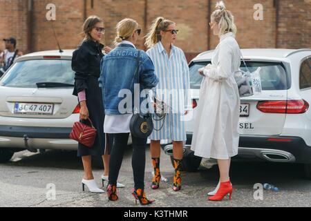 Darja Barannik, Janka Polliani, blogger and stylist Line Langmo, and Marianne Theodorsen posing outside the Ganni - Stock Photo