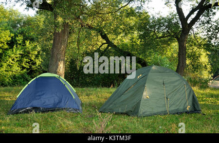 ... Two tents in the woods in the morning. - Stock Photo & A green tent in the woods in the background a beautiful lake ...
