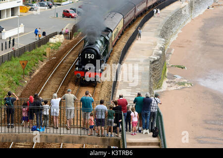 People watching the Royal Duchy steam train passing through Dawlish, hauled by LMS 4-6-0 No 46100 'Royal Scot'. - Stock Photo
