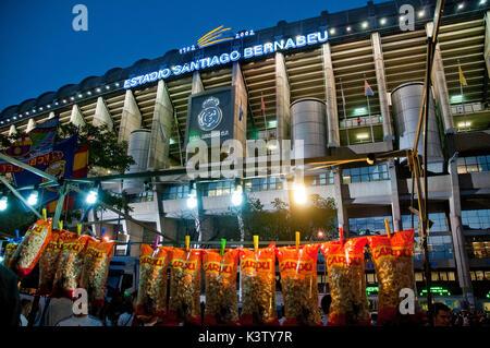 Vendor stall and atmosphere before Real Madrid-Barcelona football match. Santiago Bernabeu stadium, Madrid, Spain. - Stock Photo