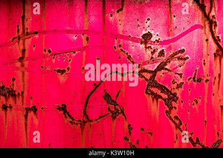 Abstract of pink rusted paint and metal