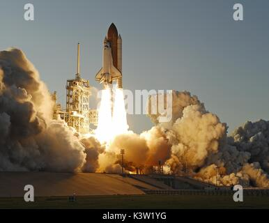 The NASA Space Shuttle Atlantis launches from the Kennedy Space Center for the STS-117 mission to the International - Stock Photo