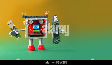Backup storage information concept. Robot with portable devices usb flash stick. Macro, green yellow gradient background - Stock Photo