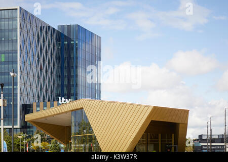 Regeneration docks area MediaCityUk at Salford Quays Gtr Manchester, gold modern architecture The Alchemist Bar - Stock Photo