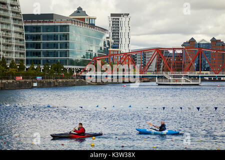 Regeneration docks area MediaCityUk at Salford Quays Gtr Manchester, water sports canoeing at Huron Basin with the - Stock Photo