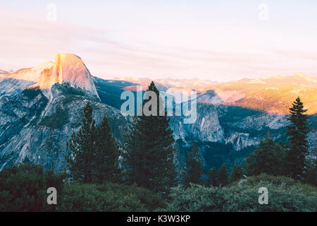 Yosemite National Park, California, USA. Sunset over the famous Half Dome Mount, view from Glacier Point - Stock Photo