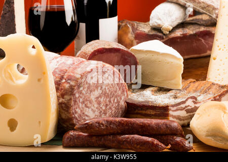 Still life, mixed salami, Mixed cheeses, typical products, red wine, Salami and cheeses, Trentino, AltoAdige, Dolomites, - Stock Photo