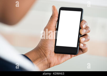 Close-up Of Woman's Hand Holding Mobile Phone With Blank Screen - Stock Photo