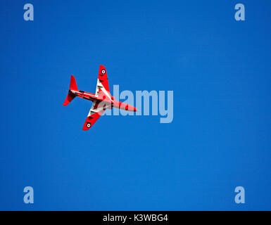 A single Red Arrow from the Royal Air Force Aerobatic Team breaking and preparing to land at Norwich Airport after - Stock Photo
